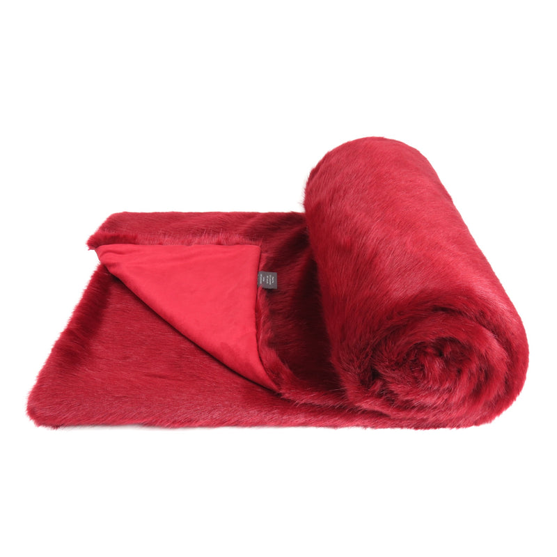 A dark red faux fur bed runner by Helen Moore