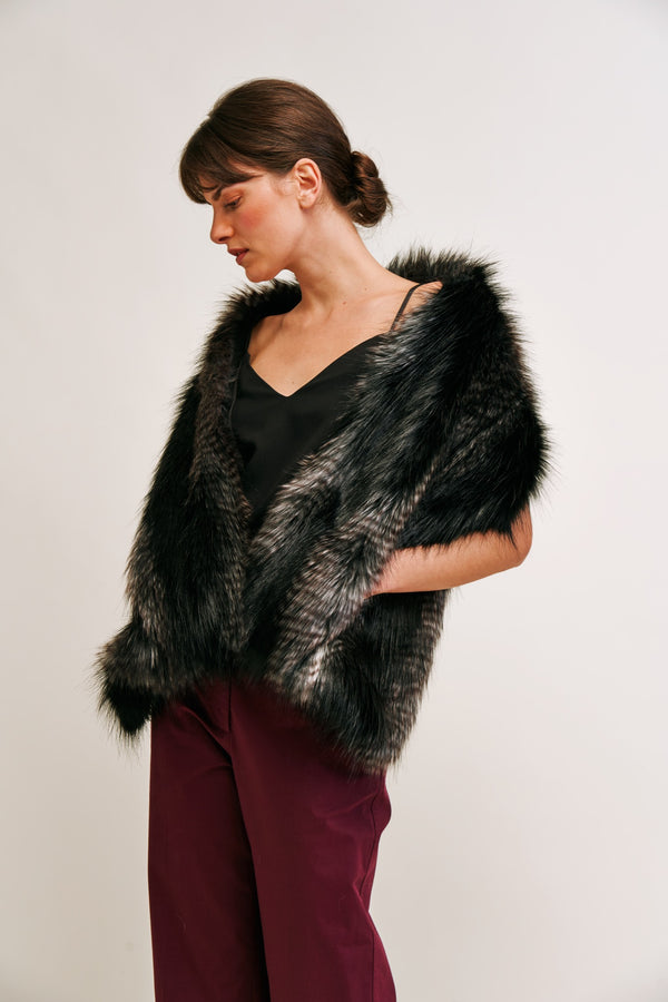 Model wearing black and grey faux fur pocket stole by Helen Moore