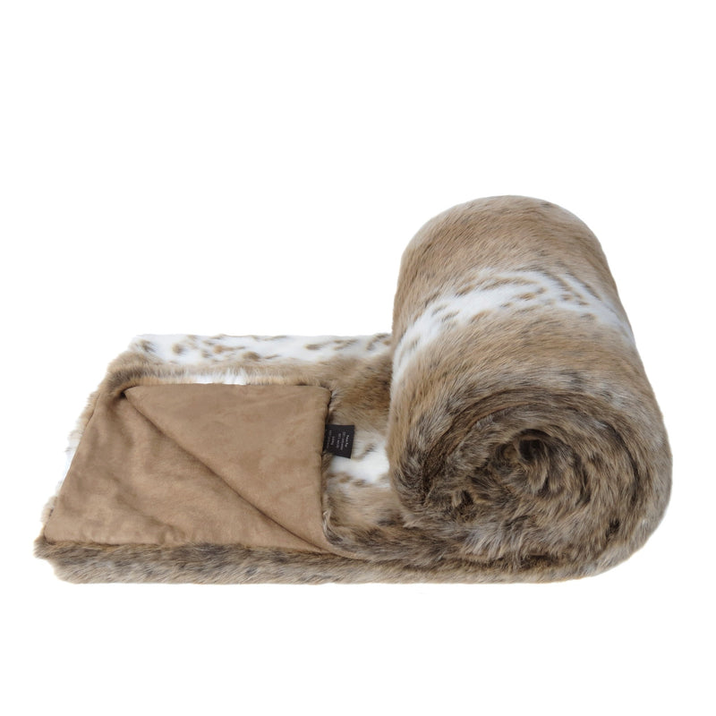 A light brown and white animal print faux fur bed runner by Helen Moore