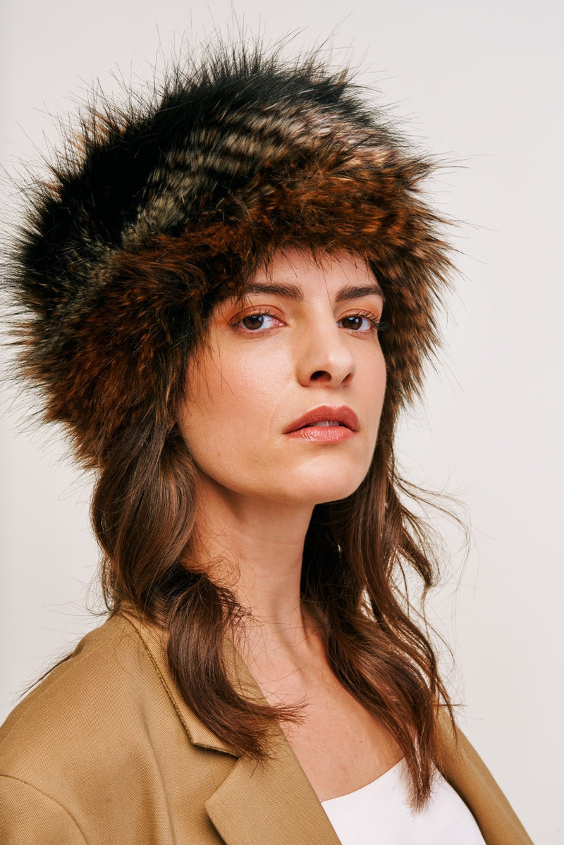 Model wearing black, brown and white feather texture faux fur pillbox hat by Helen Moore