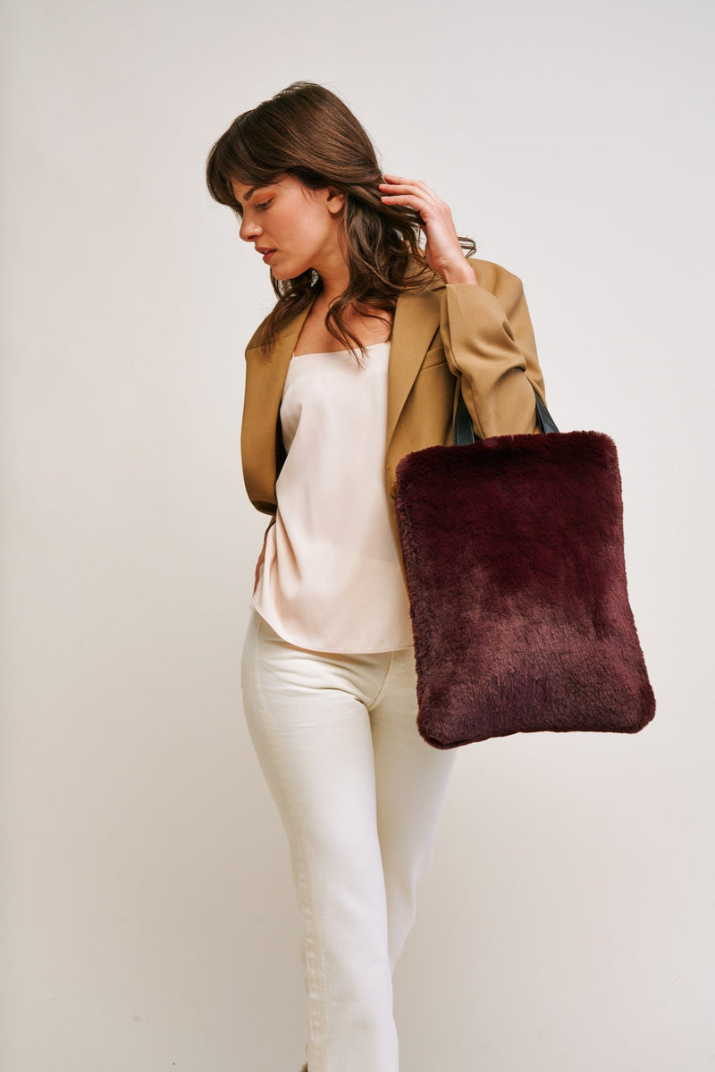 Wine Cloud Faux fur tote bag by Helen Moore