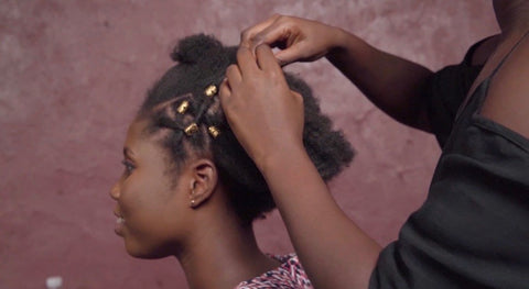 Natural Hair being styled with gold flecks
