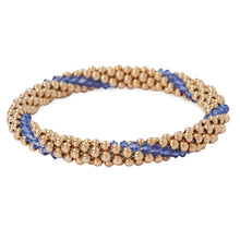 Load image into Gallery viewer, A photo of our 14KT Gold filled Beaded bracelets interlaced with Sapphire Swarvoski crystals.