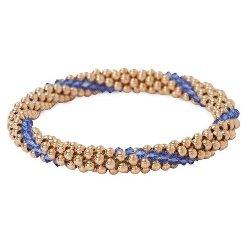 A photo of our 14KT Gold filled Beaded bracelets interlaced with Sapphire Swarvoski crystals.