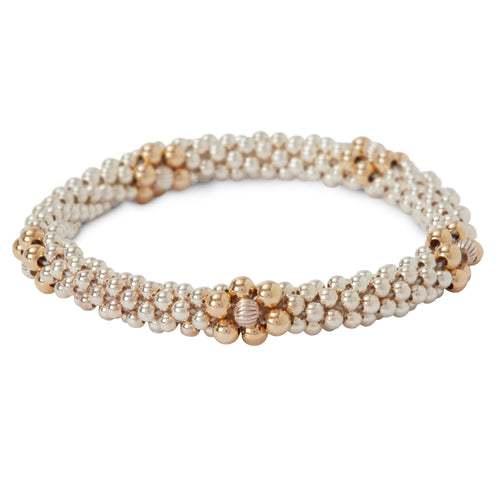 This photo shows our Sterling Silver Bracelet with Gold Flower Design
