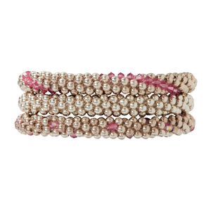 A trio of bracelets featuring, our classic sterling silver, sterling silver with rose Swarovski crystals in dot design and sterling silver with Swarovski in line design.  Beautiful combination.