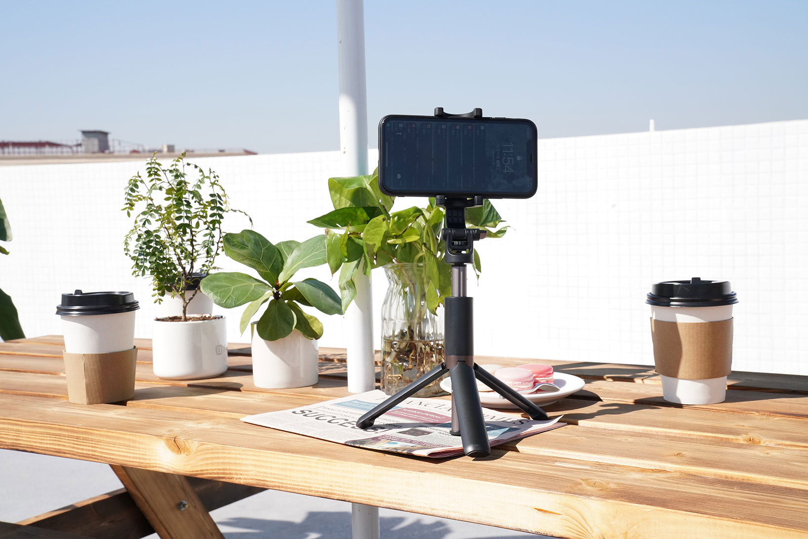 selfie stick in tripod mode and standing on a table