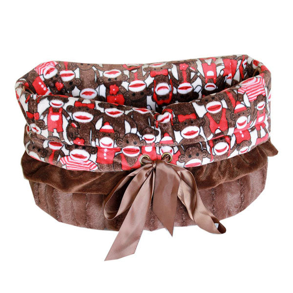 This is a pet bed, dog bed, carrier bag and Car Seat All-in-One in the color brown and with a funky monkey
