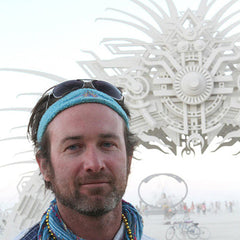 Artist Carey Thompson in front of his Burning Man Light Portal