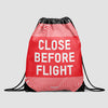 Close Before Flight - Drawstring Bag - Airportag