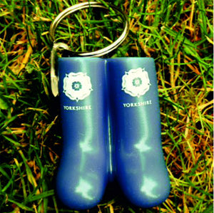Keyring in the shape of a pair of blue wellies. Printed with the Yorkshire Rose