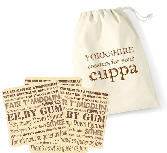 4 recycled cream leather coasters, printed with a Yorkshire Dialect design in brown, inside a cream cotton pouch also printed Yorkshire
