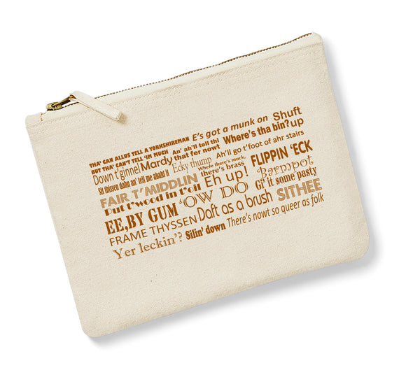 Natural cotton heavy canvas pouch 220 x 160mm, with a vintage-style gilt zip.  Features a Yorkshire Dialect design to one side