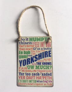 "Metal hanging sign 2.5 x 3.5"", printed full colour with Yorkshire Dialect phrases"