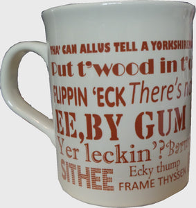 Cream earthenware mug, printed in brown with Yorkshire Dialect phrases