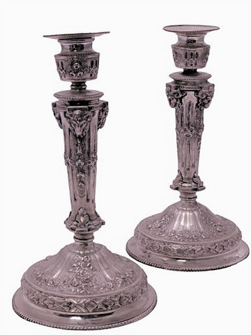 Pair of Silver Candlesticks with Unique Ram Design