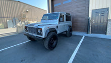 "Load image into Gallery viewer, SOLD! 1984 ""The Silversmith"" Defender 90 Left Hand Drive"
