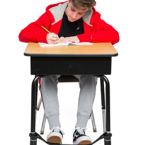A Young Boy Studying on a Desk with a Black Bouncyband