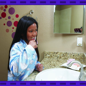 Healthy Habits Puzzle- A young girl brushing her teeth in front of a bathroom mirror