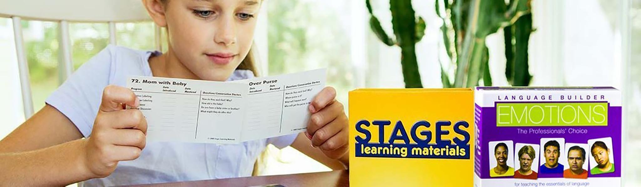 Girl looking at flashcards with set of Language Builder Emotion Cards in the forefront