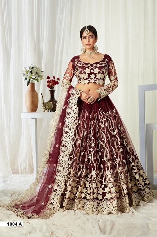 Wine Embroidered Net And Silk Lehenga Choli With Matching Blouse and Net Dupatta