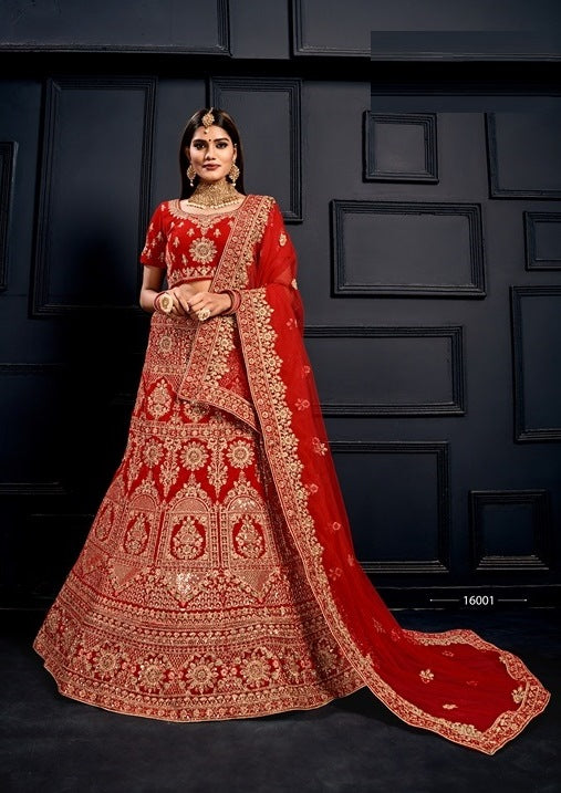Red Embroidered Velvet Lehenga Choli With Matching Blouse and Net Dupatta