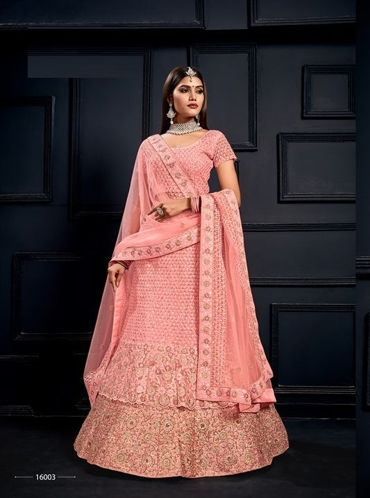 Peach Embroidered Velvet Lehenga Choli With Matching Blouse and Net Dupatta