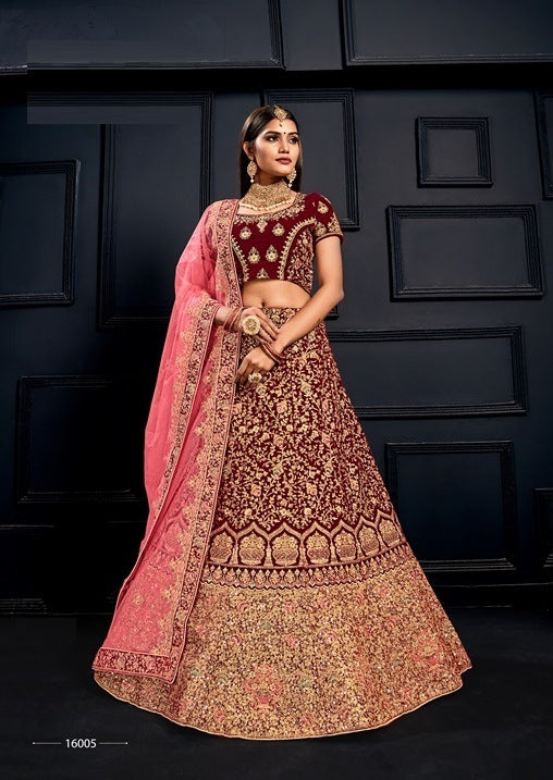 Marron Embroidered Velvet Lehenga Choli With Matching Blouse and Net Dupatta
