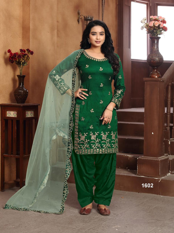Green Salwar Suit made of Art silk with Net With Heavy Glass Work Border Dupatta