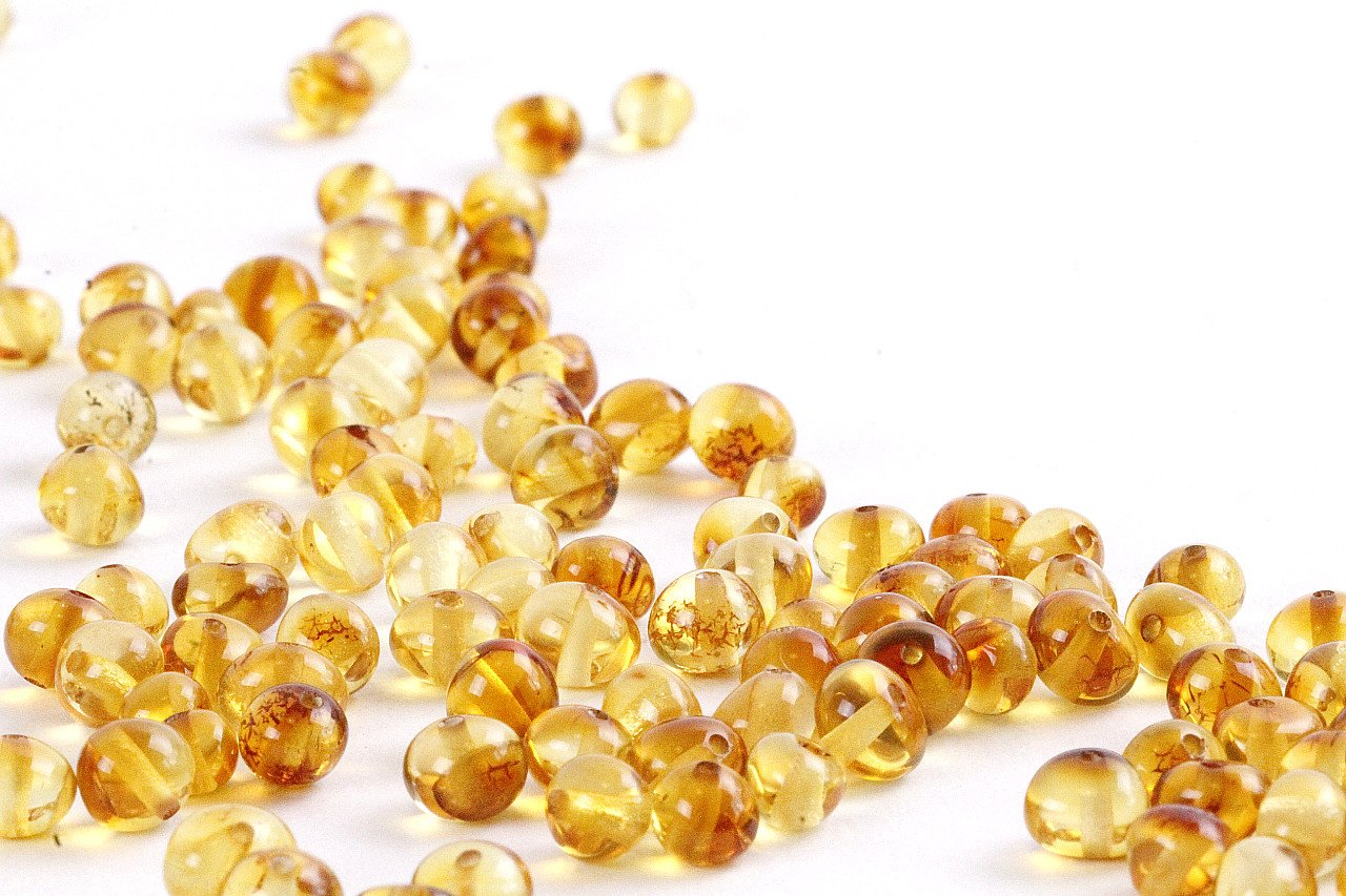 Honey Amber Beads with holes / (5mm to 5mm). Approx 90 amber beads in 10 grams - Amber SOS