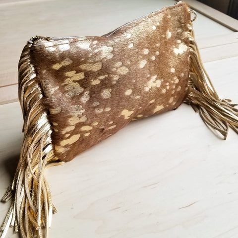 Tammy Tan and Gold Leather Clutch