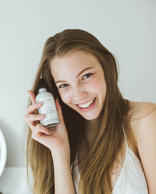 Woman smiling with Blue Azul Cleansing Oil