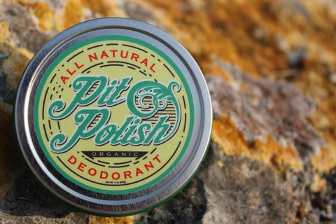 sustainable tin of natural deodorant in outdoor setting