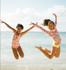 children at the beach sustainable swimwear