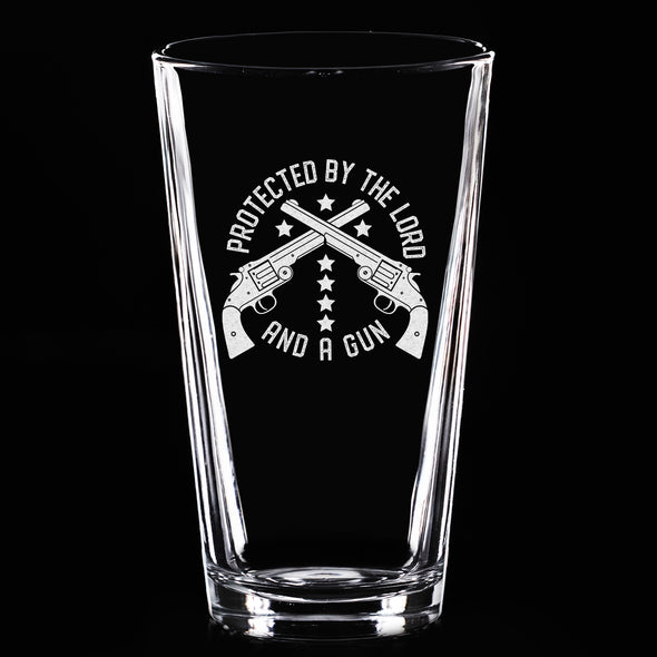 Pint Glass - Protected by the Lord and a Gun