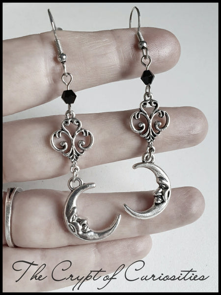 Gothic crescent moon and filigree dangle earrings.