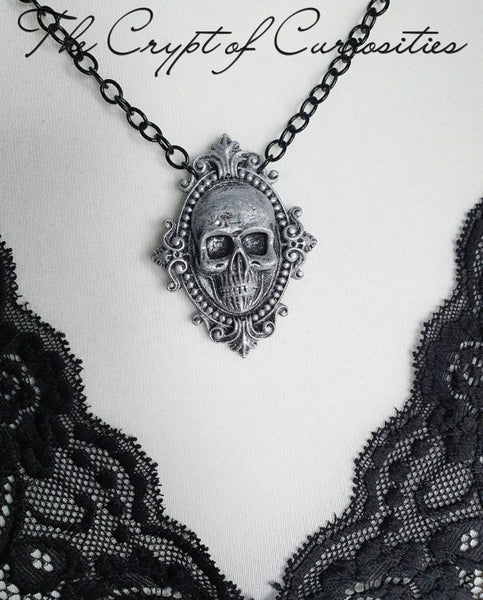 Gothic 3D silver and black filigree skull cameo necklace.