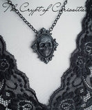 Gothic gunmetal 3D filigree skull cameo necklace.