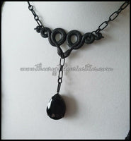 ~Without light~ Gothic black crystal drop curled snake necklace.