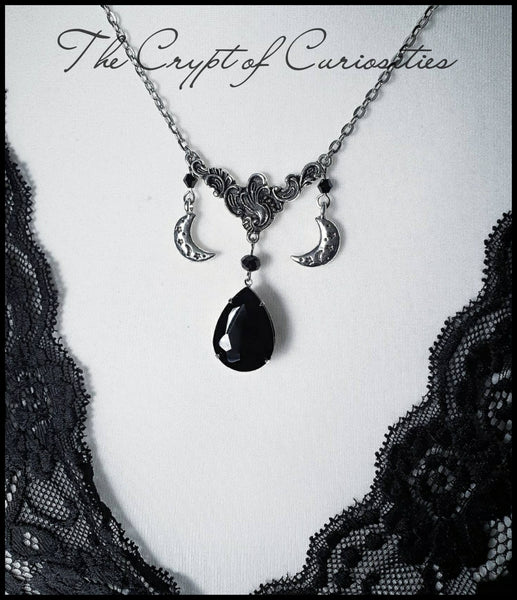 Gothic moon and star black stone filigree necklace.
