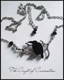 Gothic raven and tree branch crystal necklace.