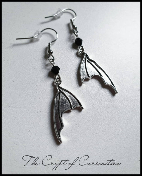 Gothic antique silver bat wing earrings.