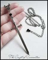 Gothic antique silver sword and black crystal necklace.
