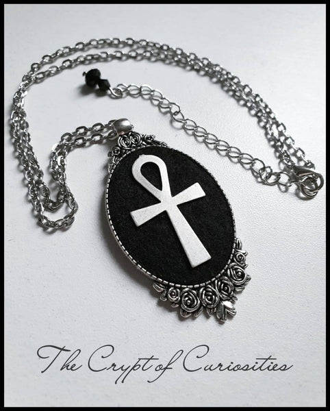 Gothic ankh and rose cameo necklace.