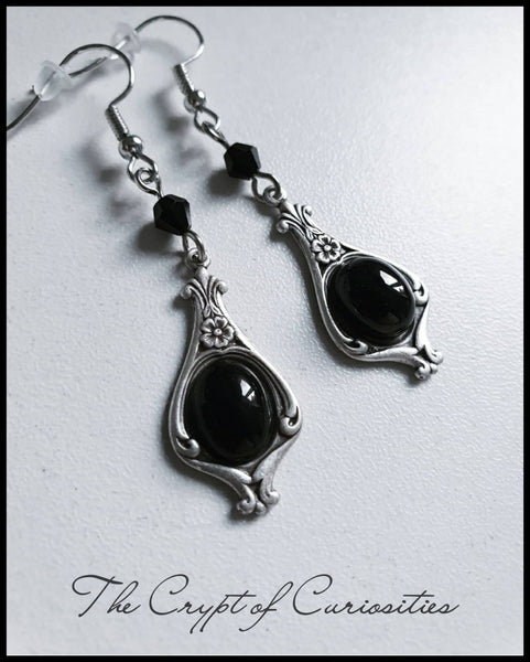 Gothic black onyx sterling silver plated cameo earrings.