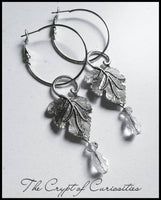 Ethereal elven inspired crystal filigree leaf dangle earrings.
