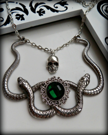 Slytherin house inspired snake and skull cameo necklace.