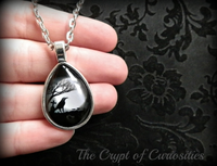 Gothic raven and full moon teardrop cameo necklace.