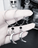 Gothic hoop and crescent moon earrings.