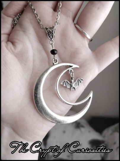 Gothic crescent moon and bat glass crystal necklace.